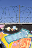 Graffiti wall with barb wire Royalty Free Stock Photos
