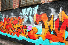 Graffiti wall in Belfast City Centre Northern Ireland. Modern Art on Belfast City brick wall Royalty Free Stock Images