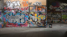 Graffiti wall in the city. The wall with city graffiti, Urban backgrounds Stock Images