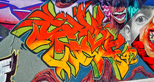 Graffiti wall. Graffiti, colorful wall  on a old building,part of the city, where artists decorated the old buildings and factories walls Royalty Free Stock Photos