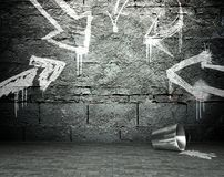 Graffiti wall with frame and arrows, street background Stock Photo