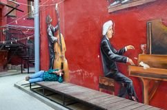Graffiti on wall of house pianist, violoncellist, Red Yard, Minsk, Belarus royalty free stock images