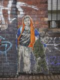 Graffiti depicting two young people. Graffiti on a wall in London, around Brick Lane street Stock Image