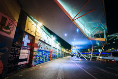 Graffiti on a wall and modern building along the Danube Canal at Stock Images