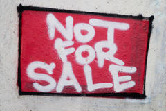 Graffiti on the wall - not for sale. Graffiti on a concrete wall - not for sale royalty free stock photography
