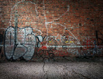 Graffiti on the wall. Graffiti on the old wall of red brick Stock Photos