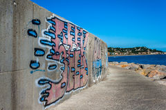 Graffiti. Wall paints near to the sea Stock Photos