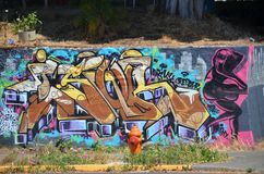 Graffiti in Portland, Oregon. This is graffiti on a wall with potted plant and fire hydrant in Portland, Oregon Stock Images