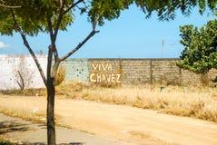Graffiti on a wall praising late Venezuelan President. Graffiti on a wall on the Isla de Margarita praising late Venezuelan President Hugo Chavez Stock Photo