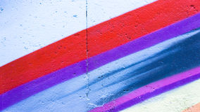 Graffiti wall. Red purple and blue paint Royalty Free Stock Images
