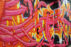 Graffiti on a wall in Sclater Street in London. A wall covered in graffiti, including a doorway Stock Photography