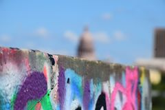 Graffiti wall with Texas State Capitol blurred in Background royalty free stock photography