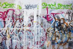 Graffiti wall. In urban background of a wall Stock Photos
