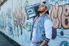 Graffiti wall young man with cap Stock Photo