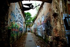 Graffiti walls in Republic of Užupis artist's quarter  in Vilnius Lithuania Stock Photos