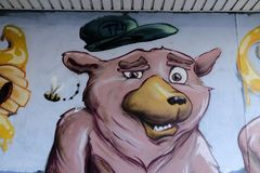 Graffiti depicting a pig like face.. Graffiti on a wallwith the image of pig like creature Stock Photos