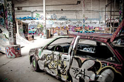 Graffiti in warehouse stock images