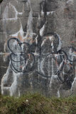 Graffiti on a weathered wall Stock Images