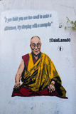 Graffiti on white wall representing the Dalai Lama. By Panos Antonopoulos. Painted outside Tibet Society offices, Kingsland Road, Haggerston, London Royalty Free Stock Images