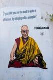 Graffiti on white wall representing the Dalai Lama Royalty Free Stock Images