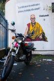 Graffiti on white wall representing the Dalai Lama Stock Photo