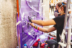 Graffiti woman with mask, spray painting. MADRID, SPAIN - APRIL 23, 2017: Artist in the event Paint Malasana! Artists, illustrators and graphic designers Stock Photos