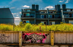 Graffiti on wooden fence in front of waterfronts condos in Point Stock Photos