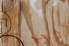 Graffiti on wooden wall. Close-up view of a wooden surface with paint and graffiti royalty free stock photos