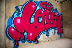 Graffiti of word love on a wall stock photo
