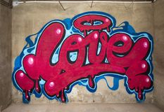 Graffiti of word love on a wall royalty free stock photos