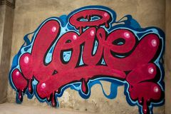 Graffiti of word love on a wall royalty free stock images