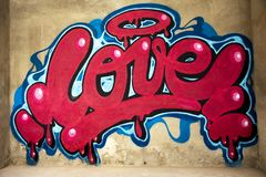 Graffiti of word love on a wall stock image