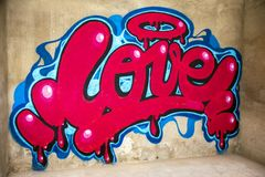 Graffiti of word love on a wall stock photography