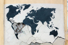 Graffiti world map on the old ruined wall Stock Photo