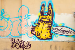 Graffiti with yellow monster on the wall Royalty Free Stock Photo
