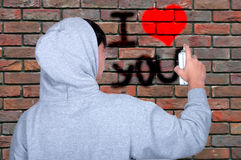 Graffiti young people on using spray paint Stock Photos