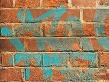 Graffitibacksteinmauer Lizenzfreie Stockbilder