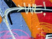 Graffitibeschriftung (WIR) Stockfotos