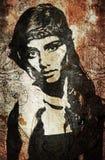 Graffitifrau auf Wand Stockfotografie