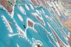 Graffitihintergrund auf Straßenwand Lizenzfreie Stockfotografie