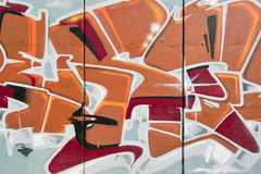 Graffito. Graffiti in warm tones and three-dimensional effect Royalty Free Stock Images