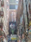 Graffito dos grafittis em Melbourne fotografia de stock royalty free