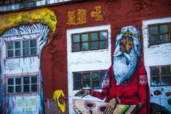 Graffity. Big graffity of an old man  in red colours Royalty Free Stock Image