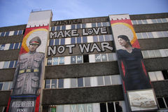 Graffity. CIRCA MARCH 2014 - BERLIN: murial on a house fassade with the slogan make Love, Not War in Berlin-Kreuzberg Royalty Free Stock Image