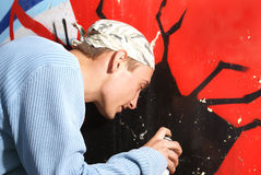 Graffity painter. Drawing a picture on the wall stock photography