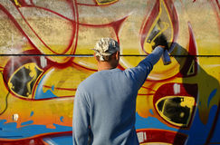 Graffity painter. Drawing a picture on the wall Royalty Free Stock Image