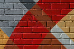 Graffity tegelstenvägg, mycket liten detalj Den abstrakta stads- gatakonstnärbilden, mode färgar, den stilfulla modellen Kan vara arkivfoto