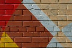 Graffitybakstenen muur, zeer klein detail Abstract stedelijk het ontwerpclose-up van de straatkunst Moderne iconische stedelijke  Stock Afbeelding
