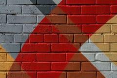 Graffitybakstenen muur, zeer klein detail Het abstracte stedelijke close-up van de Straatkunst, manierkleuren, modieus patroon Ka Stock Foto