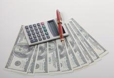 Grafici con il calcolatore, dollari di affari di soldi e Fotografie Stock